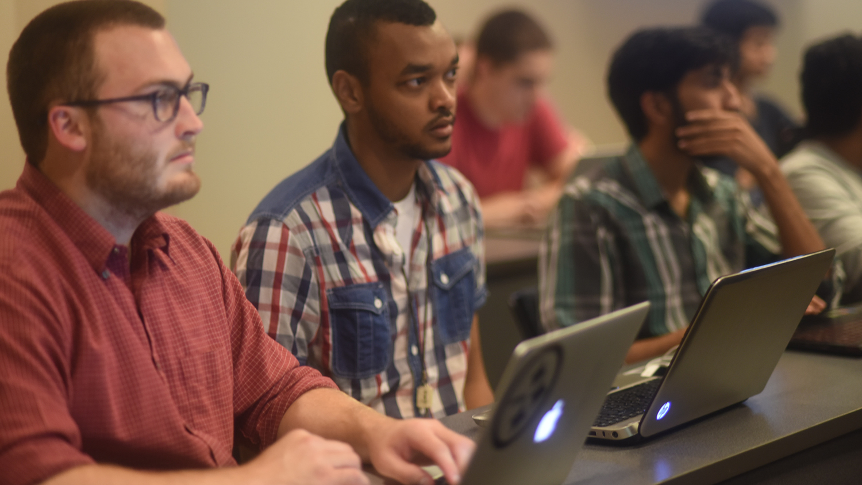 Engineering students listen in class
