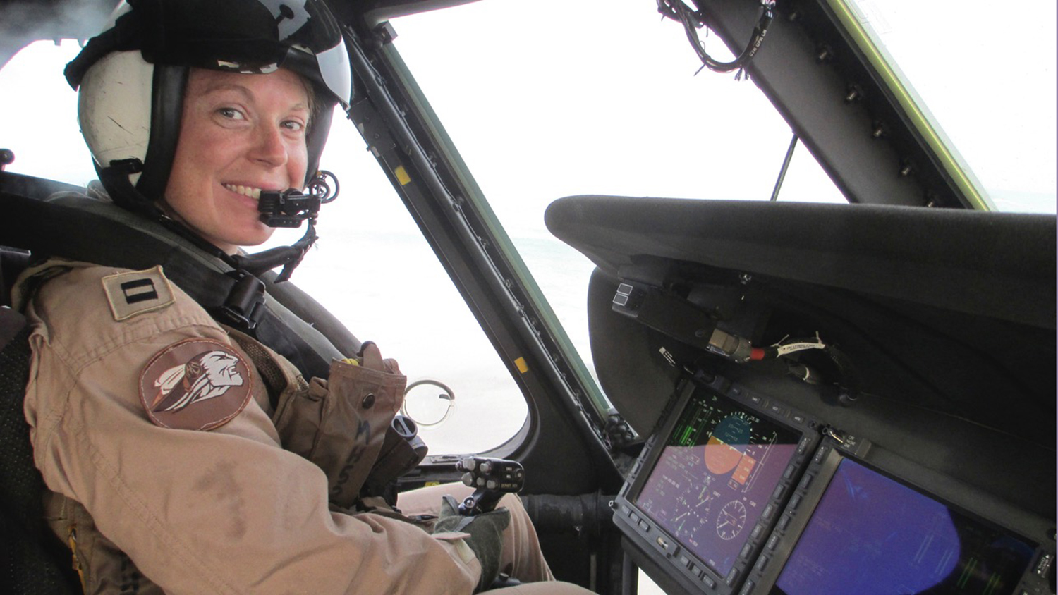 Mary Hesler, an active-duty service member and NC State Engineering Online student, sits in a helicopter.