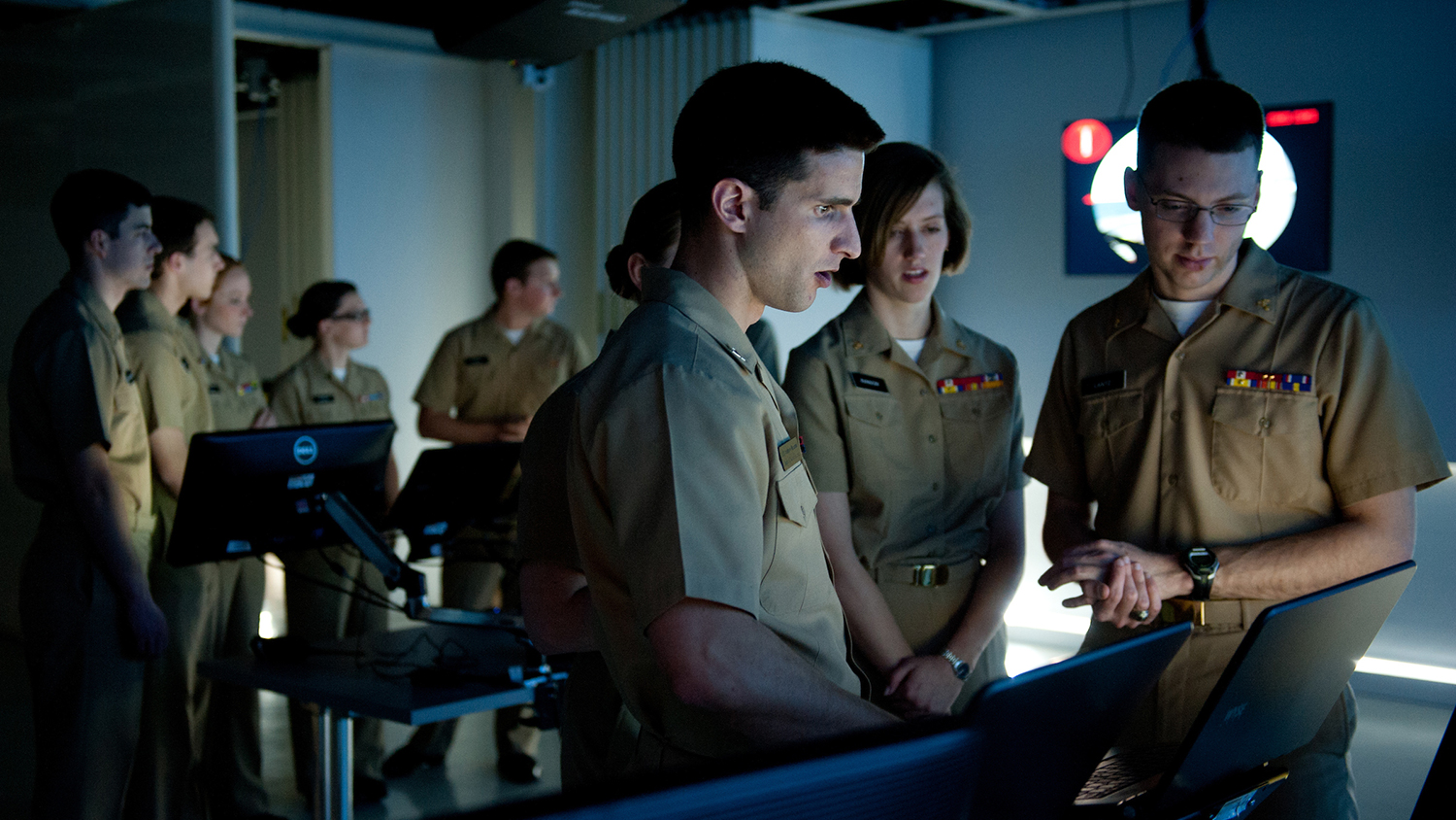 Navy ROTC students practice ship management during a virtual simulation at the James B. Hunt Library.