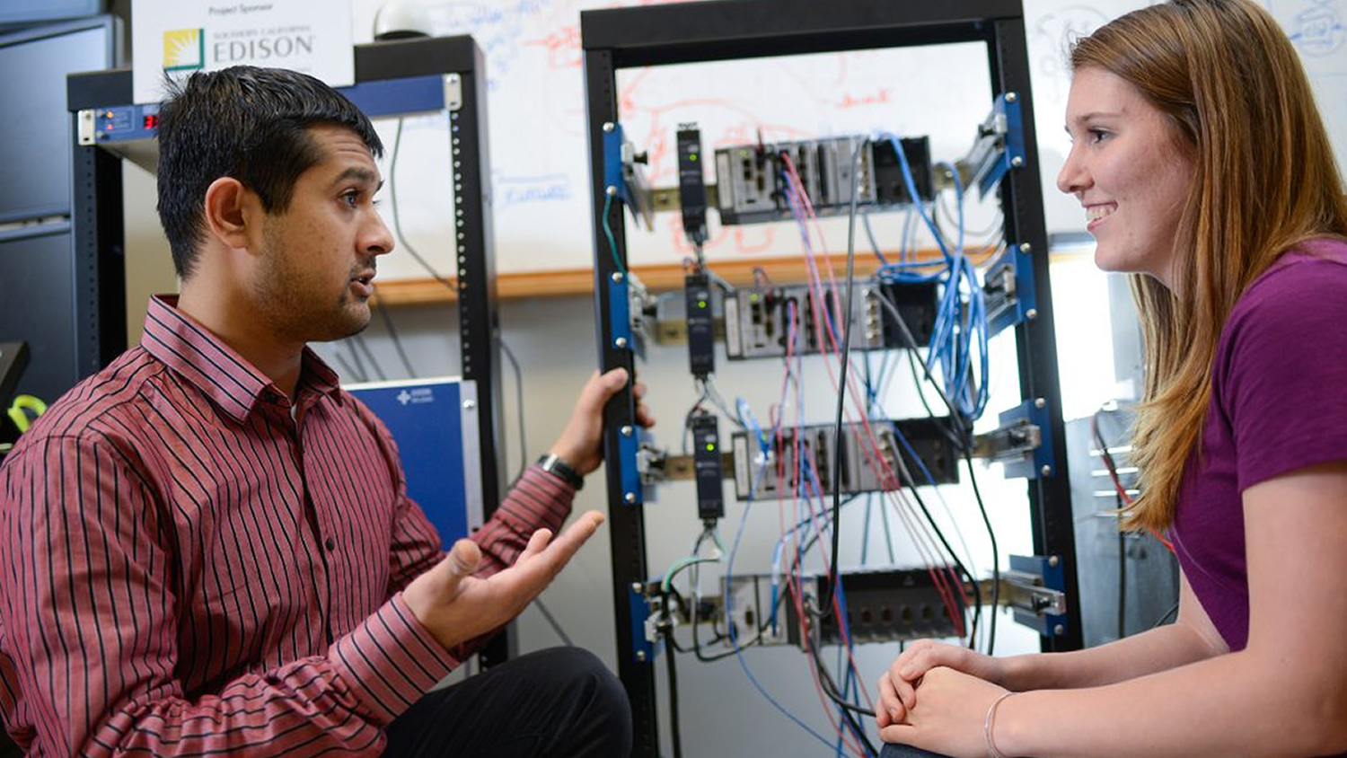 Dr. Aranya Chakrabortty (left) works with Kristrn Garcia, a graduate student in Electrical Engineering. Image credit: FREEDM Systems Center
