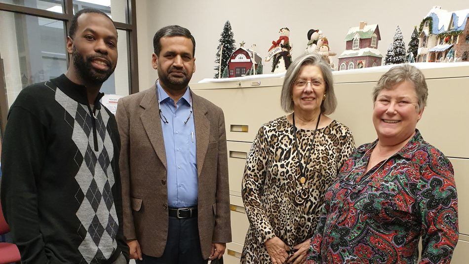 Engineering Online grad Israr Ul Haq with the Engineering Online staff on NC State's campus.